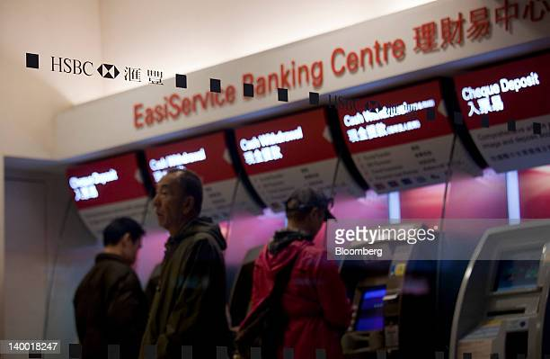 People use automated teller machines in a HSBC Holdings PLC branch in Hong Kong China on Saturday Feb 25 2012 HSBC Europe's largest bank is expected...
