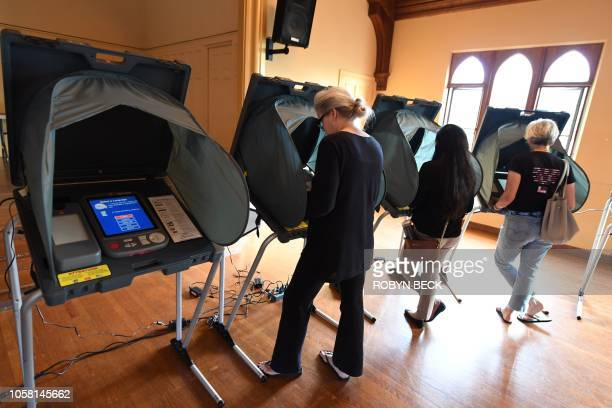 People use electronic voting machines to cast their ballot in the midterm elections at Neighborhood Congregational Church in Laguna Beach California...