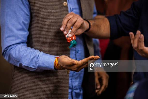People use hand sanitizer to protect themselves, on March 4, 2020 in New Delhi, India. The virus has spread to more than 150 countries and 13 states...