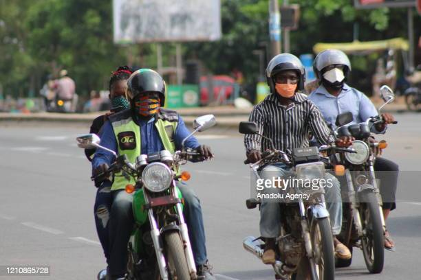 People use medical masks made of fabric as part of the precautions taken against the novel coronavirus pandemic in Lome, Togo on April 24, 2020.