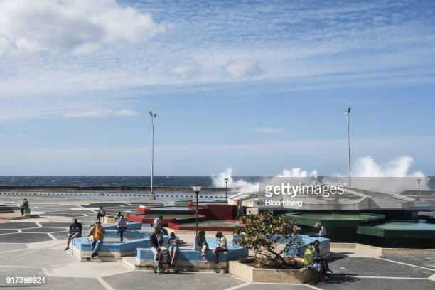 People use mobile devices at a wireless communications hotspot along the Malecon roadway in Havana Cuba on Tuesday Jan 30 2018 The Information...