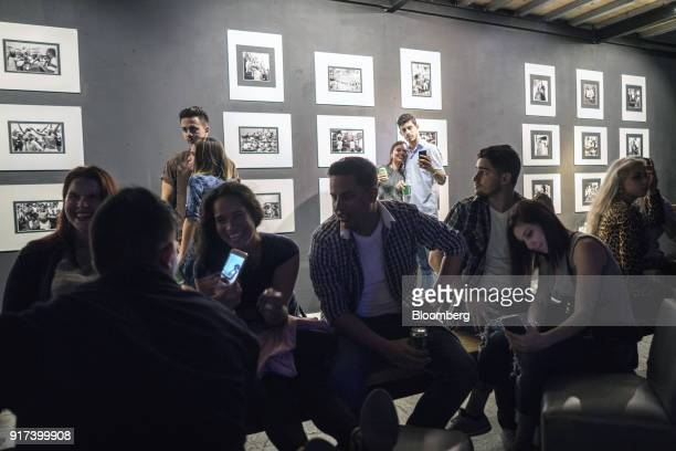 People use mobile devices at a wireless communications hotspot at a cultural center in Havana Cuba on Sunday Jan 28 2018 The Information Technology...