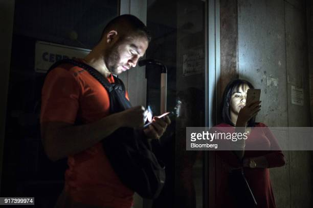 People use mobile devices at a wireless communications hotspot at night in Havana Cuba on Sunday Jan 28 2018 The Information Technology Industry...