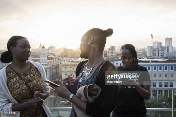 People use mobile devices at a wireless communications hotspot at the rooftop bar of the Gran hotel Manzana Kempinski La Habana in Havana Cuba on...