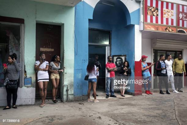 People use mobile devices at a wireless communications hotspot in downtown Havana Cuba on Friday Jan 26 2018 The Information Technology Industry...