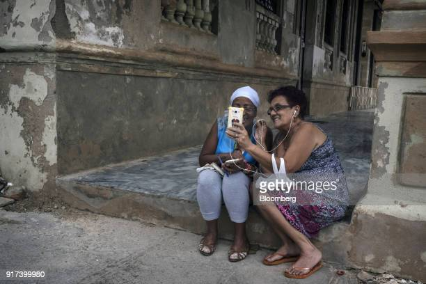 People use mobile devices at a wireless communications hotspot in Havana Cuba on Monday Jan 29 2018 The Information Technology Industry Council which...