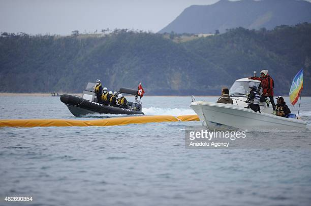 People use motor boats and kayaks to defy Japan Coast Guard in the Oura Bay to protest against the construction of the new US base of US Marines Camp...