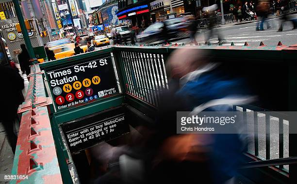 People use one of the entrances to the Times Square subway station November 26 2008 in New York City Federal officials have alerted law enforcement...