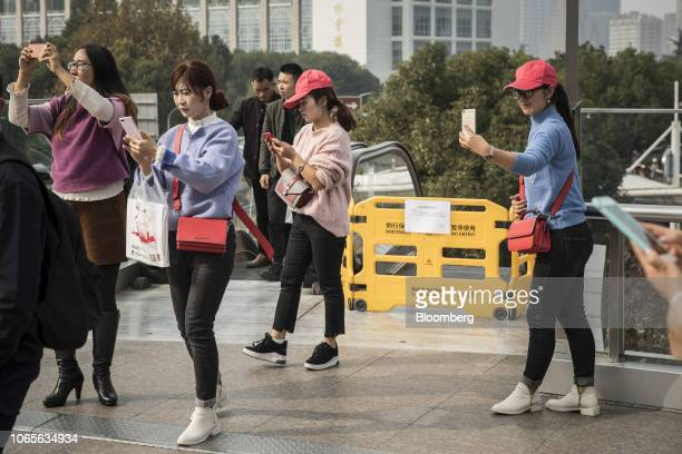 People use smartphones in Shanghai China on Tuesday Nov 27 2018 Apple which has lost a fifth of its value in a tech market rout since October is...