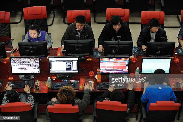 People use the computers at an Internet cafe in Taiyuan Shanxi province March 31 2010 VCP