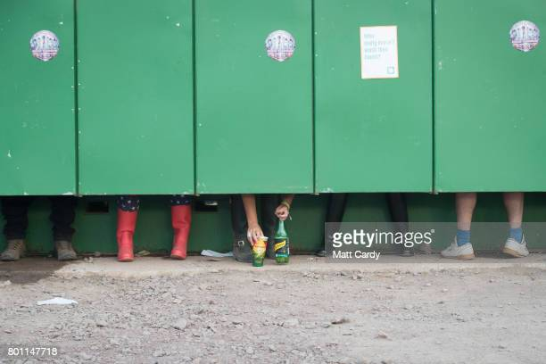 People use the toilets at the Glastonbury Festival site at Worthy Farm in Pilton on June 25 2017 near Glastonbury England Glastonbury Festival of...