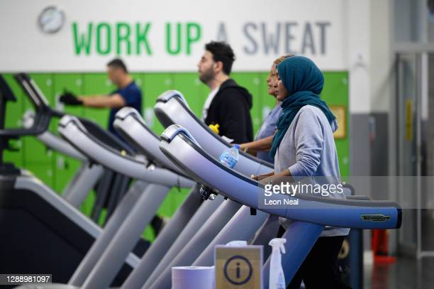 People use the treadmills in one of the gym areas at Kensington Leisure Centre on the first day of re-opening after the latest lockdown ended, on...