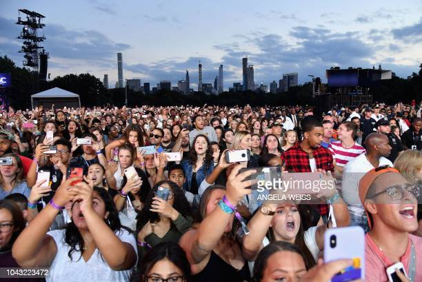 People use their mobile phones during a performance at the 2018 Global Citizen Festival Be The Generation in Central Park on September 29 2018 in New...