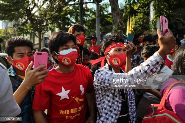 People use their smartphones to live stream a protest outside Myanmar's embassy on February 01, 2021 in Bangkok, Thailand. Myanmar's military Junta...