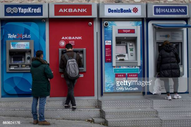 People use Turkish bank ATM machines on December 1 2017 in Istanbul Turkey The trial of Mr Reza Zarrab an IranianTurk who ran a foreign exchange and...