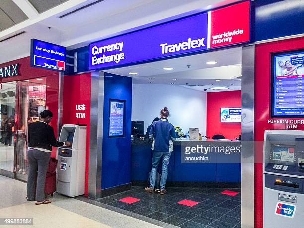 people using atm and currency exchange at atlanta airport, usa - currency exchange stock pictures, royalty-free photos & images