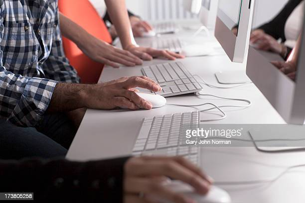 People using computers at desk