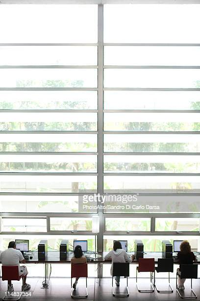 People using computers in modern building