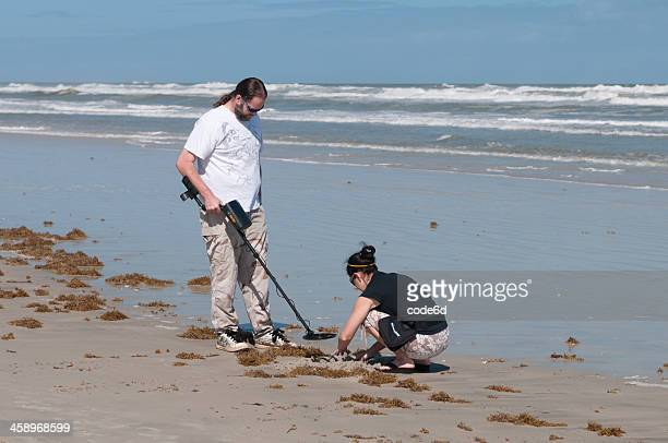 People using metal detector at Daytona Beach, Florida, USA