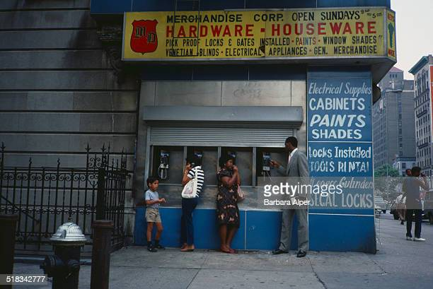 People using payphones in the street on the Upper West Side New York City USA August 1984