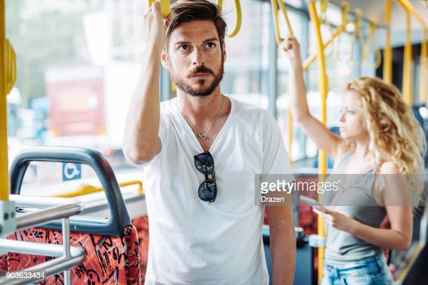 people using public bus for commuting - stranger stock pictures, royalty-free photos & images