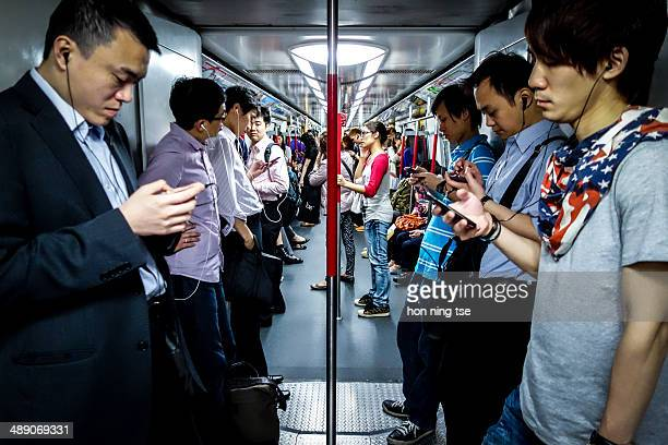 CONTENT] People using smartphone in MTR public railway in Hong Kong