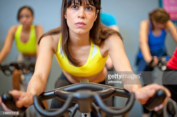 People using spin machines in gym
