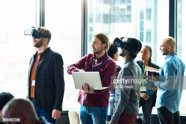 people using technology in office - virtual reality simulator stock photos and pictures