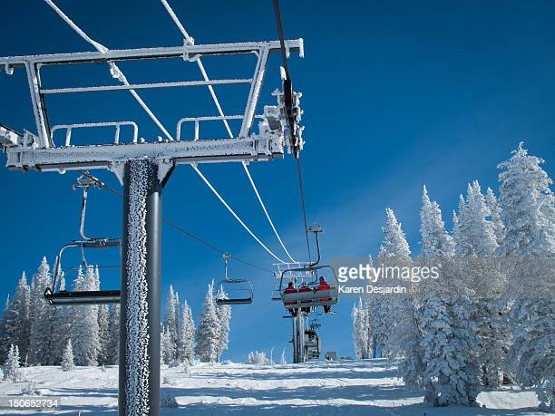 People using the chair lift at a ski resort