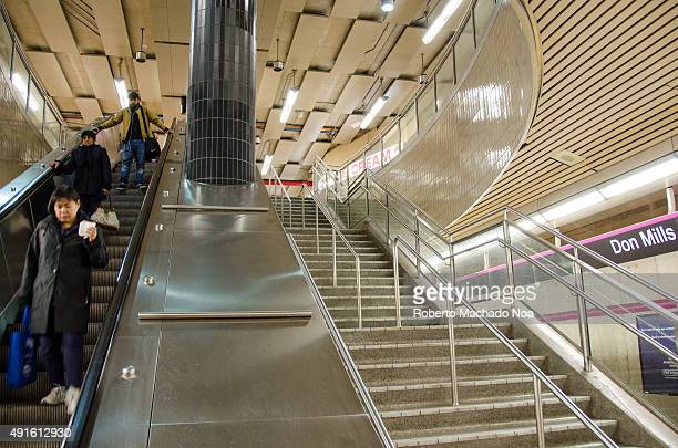 STATION TORONTO ONTARIO CANADA People using the escalator in Don Mills Station There are stairs running parallel to the escalator There is a huge...