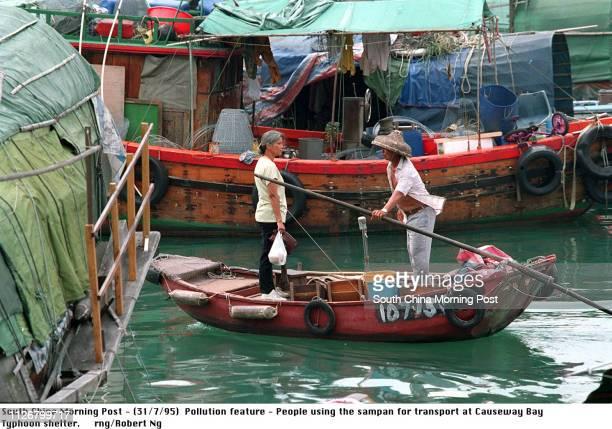 People using the sampan for transportation at Causeway Bay Typhoon Shelter Photo by Robert Ng 31 Jul 95