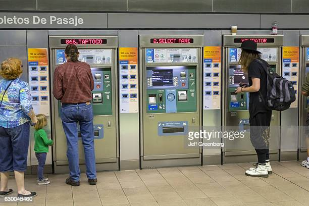 People using the ticket machines at the LA County Metro Rail