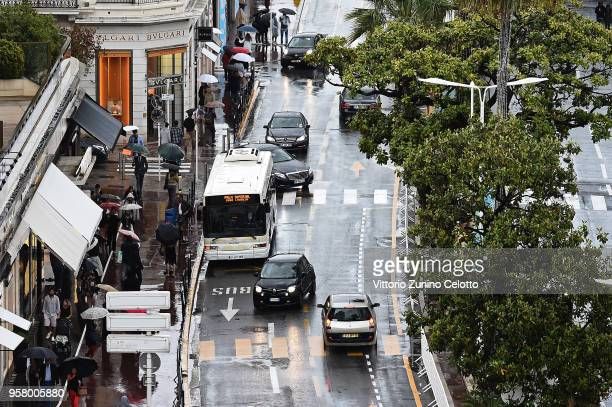 People using umbrellas are seen on the Boulevard de la Croisette as rain hits the 71st annual Cannes Film Festival at on May 13 2018 in Cannes France