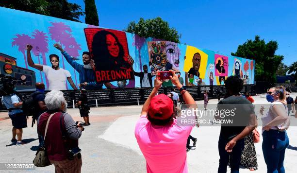 People view a 148footlong mural unveiled by the Laugh Factory as a tribute to Black Lives Matter on July 7 2020 in Los Angeles California Five...