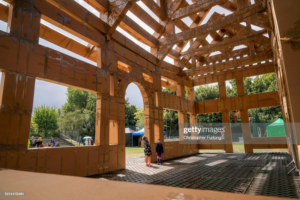 People view a cardboard recreation of a Viking stave church on display in Ashton Park, West Kirby on August 10, 2018 in Liverpool, England. The cardboard recreation of a Viking church has been built to pay tribute to the Wirral's Viking and Norse connections. The installation by French artist Olivier Grossetete's is part of the Lost Castles art project, with six ornate structures built around the Liverpool city region out of cardboard boxes and parcel tape.