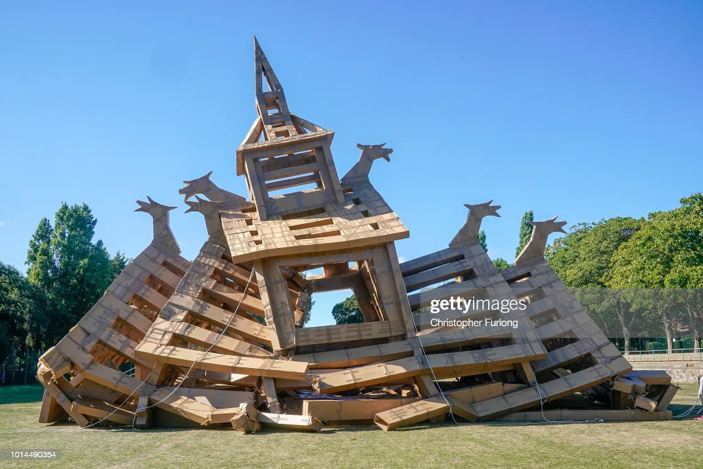 People view a cardboard recreation of a Viking stave church, which has partially collapsed in Ashton Park, West Kirby on August 10, 2018 in Liverpool, England. The cardboard recreation of a Viking church, had been built to pay tribute to Wirral's Viking and Norse connections heavy rain earlier in the day may have weakened its structure. The installation by French artist Olivier Grossetete's is part of the Lost Castles art project, six ornate structures have been built around the Liverpool city region out of cardboard boxes and parcel tape.