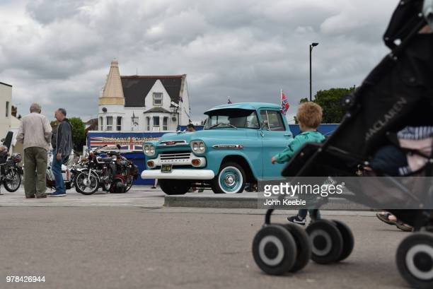 People view a Chevrolet Apache 31 American pickup truck during the Southend Classic Car Show along the seafront on June 17 2018 in Southend on Sea...