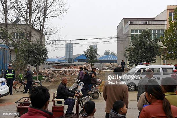 People view a collapse site of a house reconstructing project happened Friday afternoon in Wuyang County on October 31, 2015 in Luohe, Henan Province...