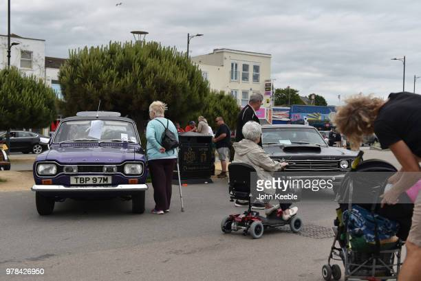 People view a Ford Escort MK1 during the Southend Classic Car Show along the seafront on June 17 2018 in Southend on Sea England