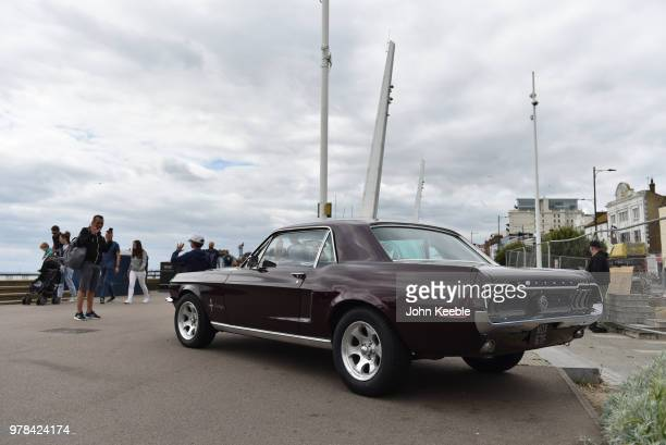 People view a Ford Mustang during the Southend Classic Car Show along the seafront on June 17 2018 in Southend on Sea England