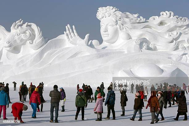 People view a large snow sculpture with the 117meterlong and 26meterhigh at the 26th Harbin International Snow Sculpture Art Expo in Sun Island park...
