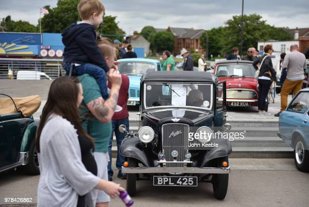 People view an Austin Seven during the Southend Classic Car Show along the seafront on June 17 2018 in Southend on Sea England