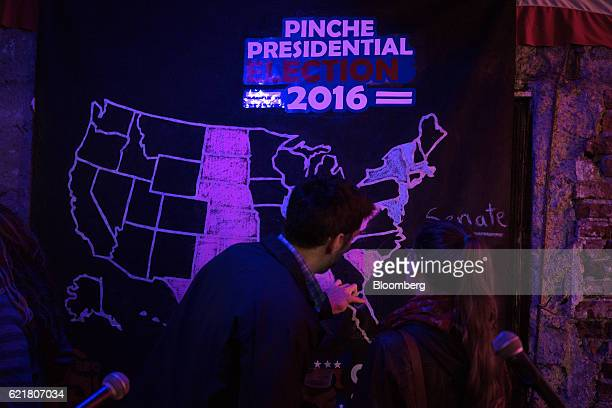 People view an electoral map during a 2016 US presidential election watch party at the El Pinche Gringo bar in Mexico City Mexico on Tuesday Nov 8...