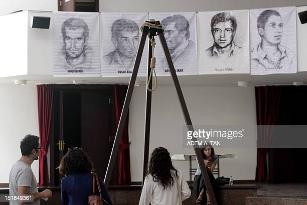 People view an exhibition in Ankara on September 12 2012 featuring images of leftist Turkish victims of the September 12 1980 military takeover a...