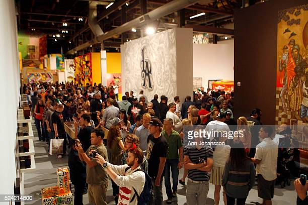 People view art on display during the member's reception of Art in the Streets at the Geffen Contemporary at MOCA in Los Angeles April 16 2011