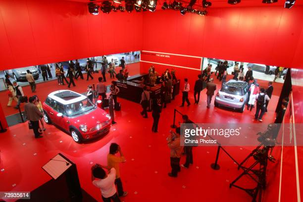 People view BMW sedans during Auto Shanghai 2007 on April 20, 2007 in Shanghai, China. More than 1,300 car makers and car components makers from 20...