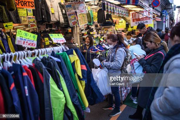 People view clothes at a discount shop in Ameya Yokocho market on January 4 2018 in Tokyo Japan Ameya Yokocho claimed to be Tokyo's last remaining...