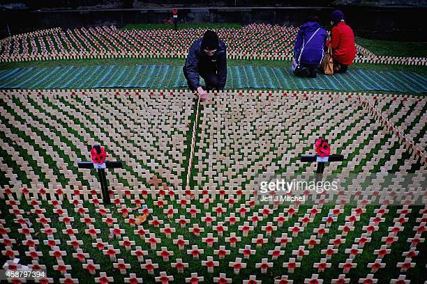 People view crosses in the garden of remembrance in Princess Street Gardens on Armistice Day on November 11 2014 in Edinburgh Scotland A two minute...