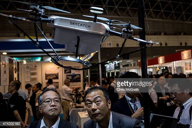 People view drones on display at the International Drone Expo 2015 at Makuhari Messe on May 21 2015 in Chiba Japan