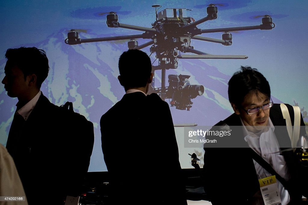 People view drones on display at the International Drone Expo 2015 at Makuhari Messe on May 21, 2015 in Chiba, Japan.